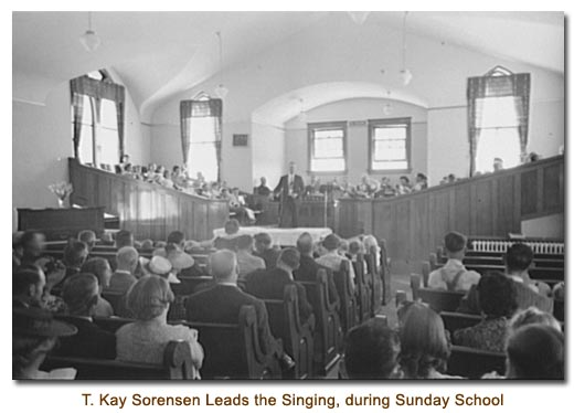 Thomas Kay Sorensen leads the singing during Sunday school