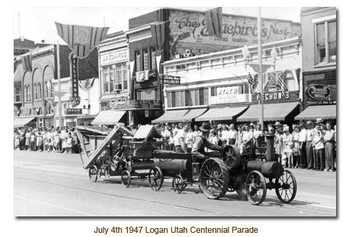 L. K. Wood drives down Main Street in Logan during the 1947 Centennial Parade.