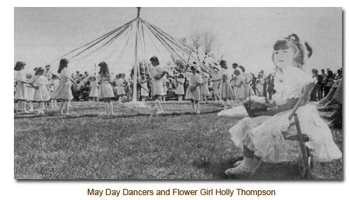 Holly Thompson, Flower Girl watches the May Day Dancers.